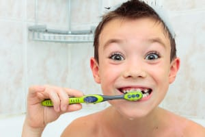 Cute Little Boy Demonstrates How to Brush His Teeth